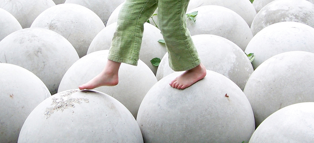 """Free Child Walking on White Round Spheres Balance"" © D Sharon Pruitt"