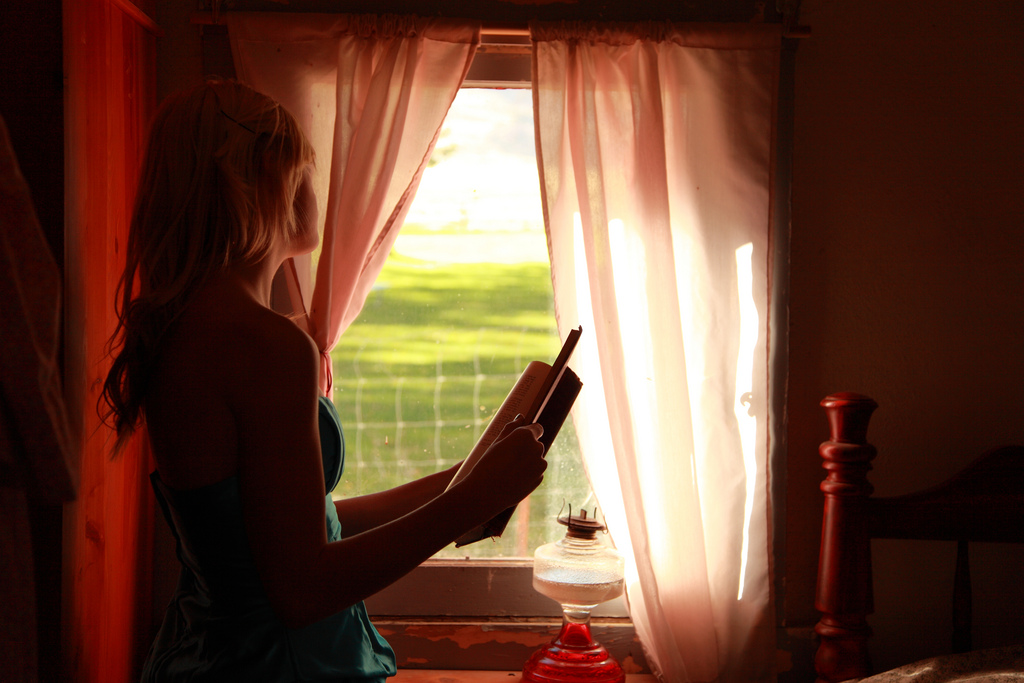 """""""Girl Holding Book Looking Out Window"""" © D Sharon Pruitt; Creative Commons license"""