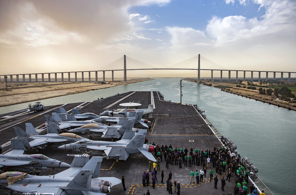 """The USS George H.W. Bush at the Friendship Bridge"" © U.S. Navy, photo by Mass Communication Specialist 3rd Class Michael B. Zingaro; Creative Commons license"