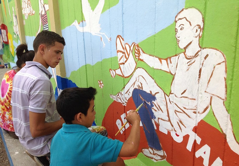 """Painting School Mural in San Juan de Limay, Nicaragua"" (2014) © Maria Gabriela Aldana; used courtesy Art of Solidarity"