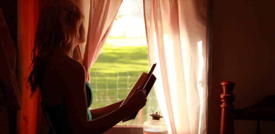"""Girl Holding Book Looking Out Window"" © D Sharon Pruitt; Creative Commons license"