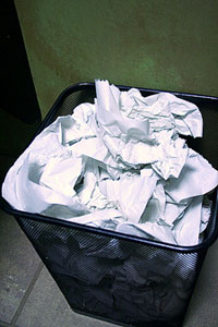trash can filled with crumpled papers