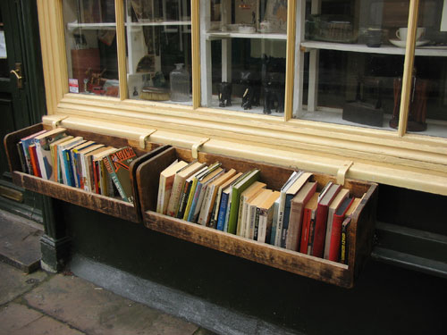 Books in a flowerbox outside a shop
